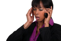 Office worker receiving bad news. Over the telephone Royalty Free Stock Photos