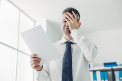 Office worker receiving a dismissal letter Stock Image