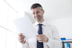 Office worker receiving a dismissal letter Stock Photo