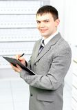 Office worker records Royalty Free Stock Photo