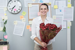 Office worker with red roses Royalty Free Stock Photos