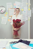 Office worker with red roses Stock Photography