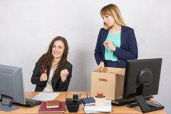 Office worker rejoices that dismissed colleague collects things Royalty Free Stock Images