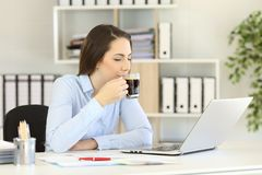 Office worker relaxing drinking coffee royalty free stock photo