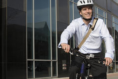 Office worker riding bicycle stock image