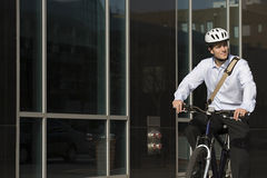 Office worker riding bicycle stock photography