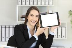 Office worker showing an horizontal tablet screen. Happy office worker showing an horizontal tablet screen mock up Royalty Free Stock Images