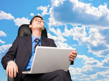 Office worker at sky background Stock Photo