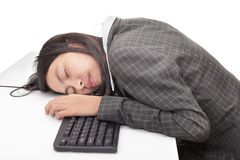 Office worker sleeping on desk Stock Photo