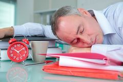 Office worker sleeping on desk Royalty Free Stock Photo