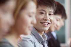 Office Worker Smiling and Looking at Camera Stock Images