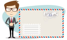 Office worker stands near a large mailer envelope Royalty Free Stock Images