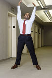 Office worker stretching in corridor Royalty Free Stock Photos