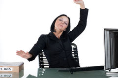 Office worker stretching at desk Royalty Free Stock Images