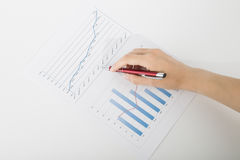 Office worker studying the chart with a pen Royalty Free Stock Image