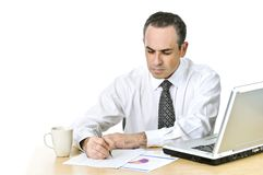 Office worker studying reports Stock Image