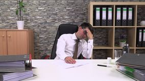 Office worker suffers a headache. And drinks a tablet with water stock footage