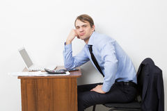 Office worker takes break from his work. He is. Office worker takes a break from his work. He is sitting with a sour face Royalty Free Stock Photo