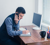 Office worker takes an order by phone Stock Image