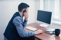 Office worker takes an order by phone Stock Photos