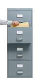 Office worker taking a file from a filing cabinet Royalty Free Stock Image
