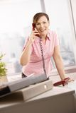 Office worker talking on phone Stock Image