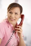 Office worker talking on phone Stock Images