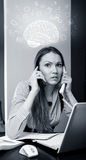 Office worker talking on two cell phone Royalty Free Stock Images