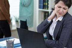 Office worker with tense neck muscles Stock Photo