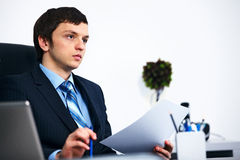 Office worker thinking in office Royalty Free Stock Images