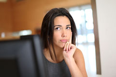 Office worker with thoughtful look Royalty Free Stock Photos