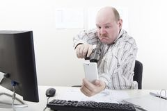 Office Worker Threatening His Phone stock images