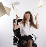 Office worker throws paperwork into the air Stock Photo