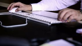 Office worker typing on computer keyboard. Office worker. Business Man typing on computer keyboard in office stock video footage