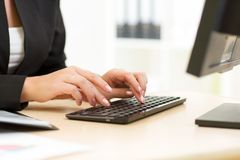 Office worker typing on keyboard Royalty Free Stock Photo