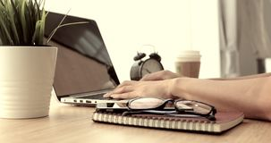Office worker typing on laptop. stock footage