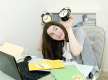 Office Worker under Time Pressure. Silly representation of business woman under time pressure during 8 hour office day Stock Photo