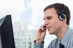 Office worker using a headset Stock Photos