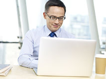 Office worker using laptop computer Stock Image