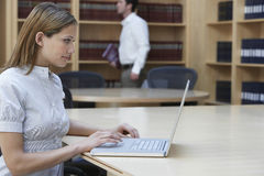 Office Worker Using Laptop In Office Stock Image