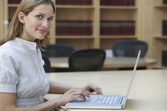 Office Worker Using Laptop In Office Stock Photography