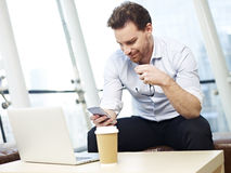 Office worker using mobile phone Stock Images
