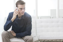 Office worker using smartphone Stock Images