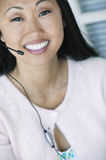 Office Worker Using Telephone Headset Royalty Free Stock Images