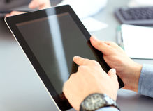 Office worker using a touchpad to analyze statistical data Royalty Free Stock Photo