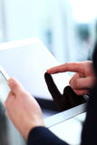 Office worker using a touchpad to analyze statistical data Stock Images