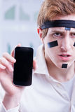 Office worker warrior with smartphone Stock Images