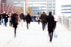 Office worker on the way to the office. Office worker in motion blur walking on a sidewalk Stock Photography