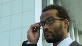 Office worker wearing eyeglasses outdoors, non-surgical vision correction. Stock footage stock video