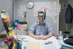 Office worker wearing scuba mask. Smiling office worker wearing scuba mask with negative business chart on background Royalty Free Stock Image